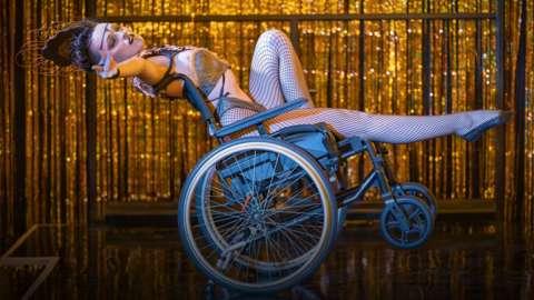 A woman in a wheelchair performing burlesque