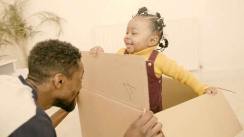 A father and daughter playing at home