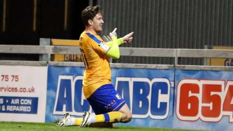 Andy Cook celebrates his late equaliser for Mansfield