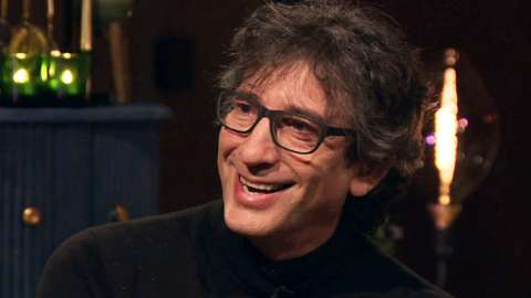 Picture of Neil Gaiman wearing a black sweater smiling
