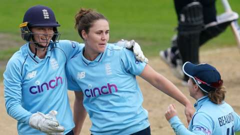 Amy Jones, Nat Sciver and Tammy Beaumont celebrate a wicket