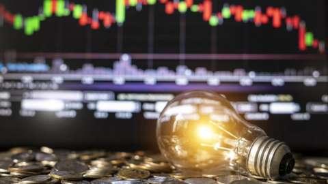 Light bulb on money