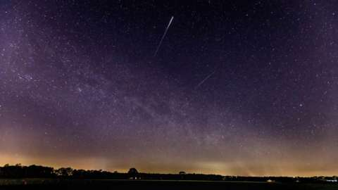 A meteor of the lyrids in the sky is seen on 22 April, 2020 in Schermbeck, Germany