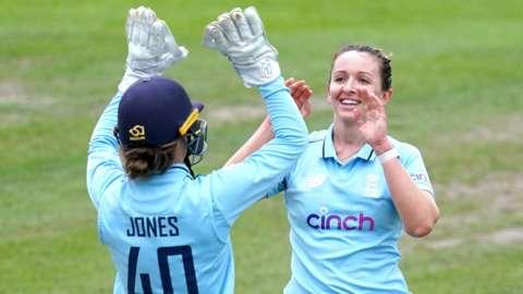 England's Amy Jones and Kate Cross celebrate a wicket