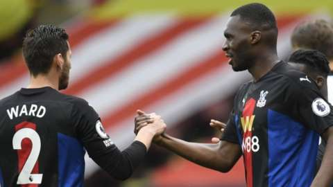 Joel Ward shakes hands with Christian Benteke after the Crystal Palace striker's goal against Sheffield United