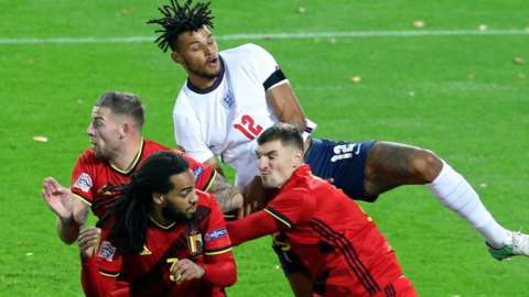 England's Tyrone Mings challenges