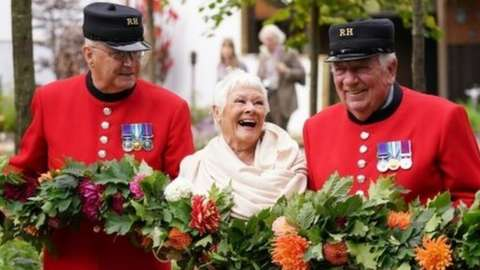 Dame Judi Dench with Chelsea Pensioners during the RHS Chelsea Flower Show
