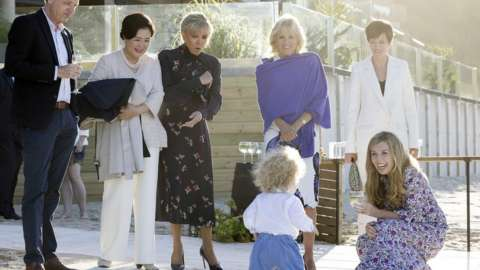 Carrie Johnson with Wilfred Johnson as Kim Jung-Sook, Jill Biden, Brigitte Macron look on