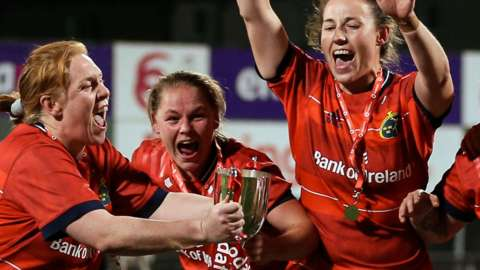 Munster celebrate with the interprovincial trophy