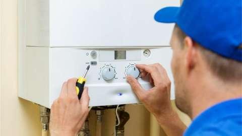 Plumber working on gas boiler