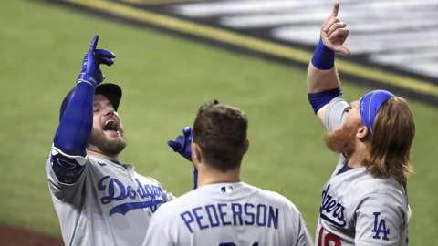 Dodgers trio Max Muncy, Joc Peterson and Justin Turner celebrate a home run