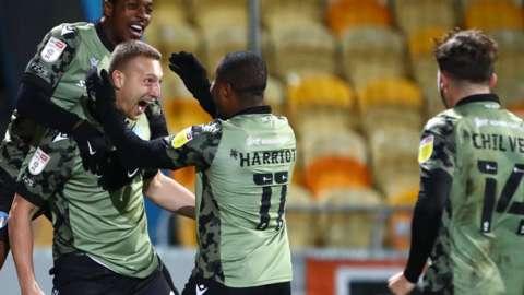 Luke Norris's 85th-minute equaliser ended Nigel Clough's winning start as Mansfield boss