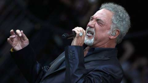 Tom Jones performing on stage