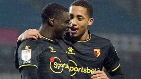 Ken Sema celebrates scoring Watford's third goal