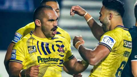 Wigan's Tommy Leuluai celebrates his try with Bevan French and team-mates