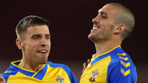 Oriol Romeu celebrates after scoring the winning penalty