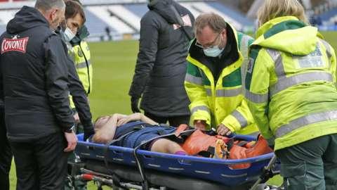 Jordan Morris is taken off on a stretcher