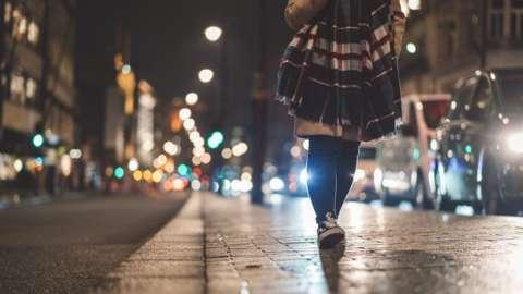 Young woman at Piccadilly Circus at night
