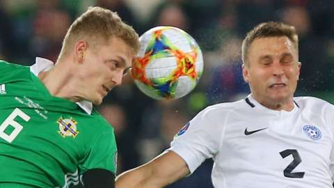 NI midfielder George Saville beats Estonia's Gert Hams to the high ball
