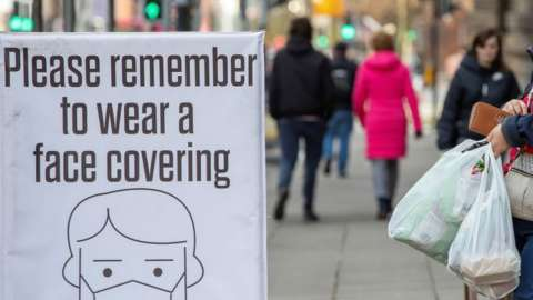 Face coverings remain mandatory in shops and several other indoor settings in Northern Ireland