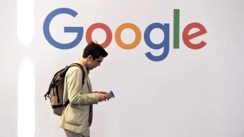 Google worker walking into office.