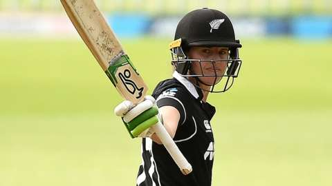 New Zealand batter Amy Satterthwaite raises her bat in celebration after hitting a century in the third ODI against England