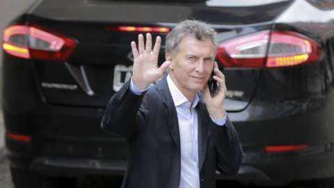 Argentina's President-elect Mauricio Macri waves to journalists after a press conference in Buenos Aires, Argentina, on 23 Nvember, 2015.
