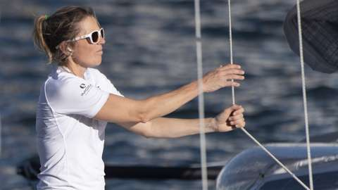 Sam Davies on her boat arriving into Cape Town
