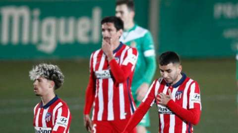 Atletico Madrid players look dejected