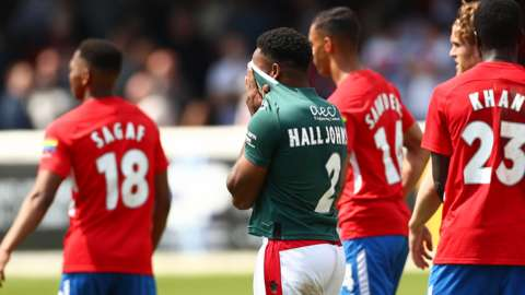 Reece Hall-Johnson is dejected after Wrexham miss out on the play-offs