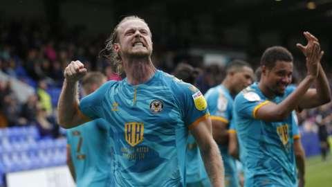 Alex Fisher celebrates Newport goal