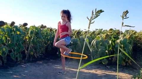 Girl hula-hooping