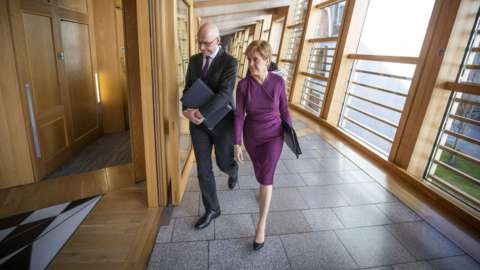 Scottish First Minister Nicola Sturgeon and Deputy First Minister John Swinney arrive ahead of First Minister's Questions (FMQ's) in the debating chamber of the Scottish Parliament on March 19, 2020 in Edinburgh