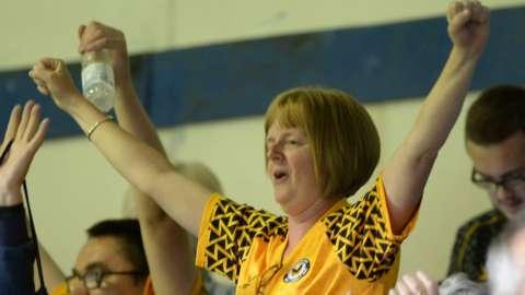 A Newport fan celebrates