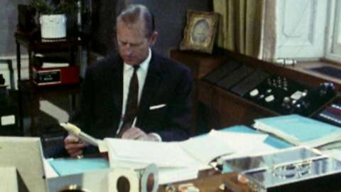 Prince Philip, at home in his study