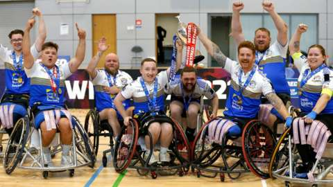 Leeds wheelchair rugby league club celebrate with the Challenge Cup