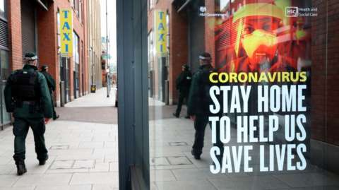 Undated handout photo issued by PSNI showing officers patrol Belfast city centre during the coronavirus lockdown