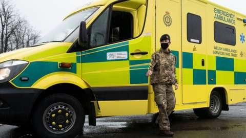 Solider outside an ambulance