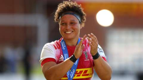 Shaunagh Brown smiles and claps