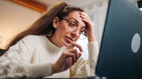 Stressed woman during conference call