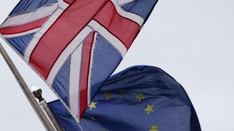 A Union Jack pictured next to the European Union flag