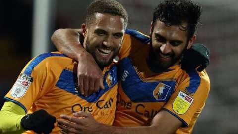 Mansfield celebrate Jordan Bowery's goal against Salford