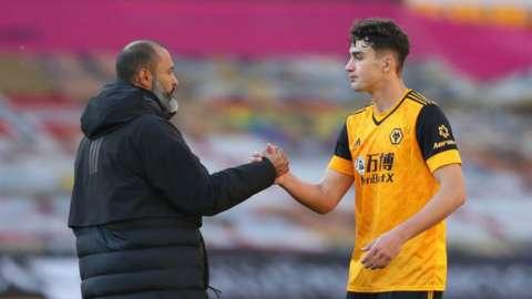 Wolves defender Max Kilman shakes hands with boss Nuno Espirito Santo