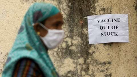 A notice about the shortage of coronavirus disease (COVID-19) vaccine supplies is seen at a vaccination centre, in Mumbai, India, April 8, 2021.