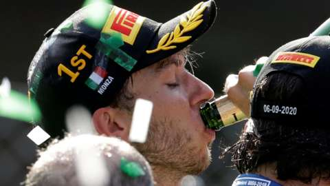 Pierre Gasly drinks champagne