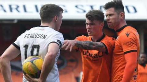 Aberdeen midfielder Lewis Ferguson and two Dundee United opponents