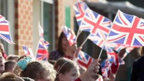 Children waving union jacks