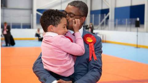 Vaughan Gething celebrates with his son Isaac, aged 6