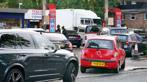 Drivers queue for fuel at a petrol station in Birmingham