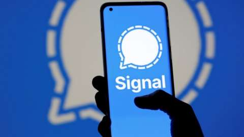 The Signal messaging app logo is seen on a smartphone